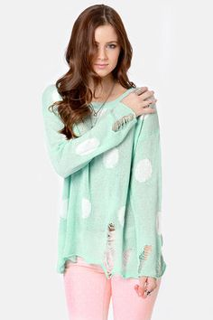 Check it out from Lulus.com! Your favorite sweater is all grown up and adding some edge to those sweet pastel polka dots! The Loved to Shreds Mint Polka Dot Sweater strikes the perfect balance with darling mint green and white polka dots on an open sweater knit, plus cool shredded details along the rolled hemline and sleeve cuffs to push it fashion-forward. Oversized shape with a ribbed, wide scoop neckline provides a stylishly slouchy fit. Unlined and slightly sheer. Model is wearing a size…