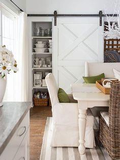 Beautiful sliding barn door covering kitchen storage area