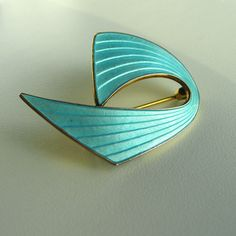Aksel Holmsen silver enamel Viking ship brooch, with gold-washed back. In deep cyan/turquoise. I bought a red one of these for my wife, thinking it was just a lovely shape. Only later did I realise that it was a stylised Viking ship in full sail. Enamel Jewelry, Jewellery, Full Sail, Viking Ship, Gold Wash, Silver Enamel, Brooches, Things To Think About, Scandinavian