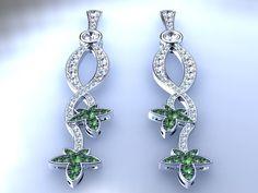 pendientes de oro, tsavoritas y brillantes. 18 k golden earrings with diamonds and tsavorites. Ana G.Näs