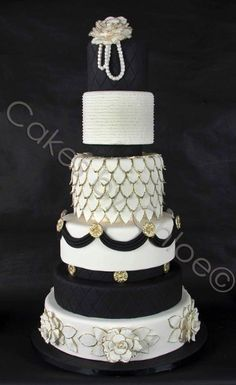 There is a lot going on with this cake, one layer looks like fish scales...