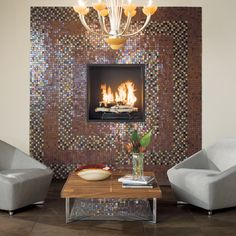"""This American Olean living area features Solare Glass Tile Mosaics in Amber and Autumn Blend in 1"""" x 1"""" field tile shown around the fireplace. Metroplex tile in Umber 13"""" x 19"""" shown on the floor in a grid pattern. See more at americanolean.com"""