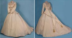 The dress beneath silk was used by Mrs. Alonzo H. Wood in 1868. The wedding was held so Alonzo H. Wood returned from war.