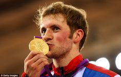 Champion: Jason Kenny kisses his sprint gold medal after a phenomenal victory over French world champion Gregory Bauge - it is his second gold of London 2012.  Team GB now has 6 medals in 7 track cycling events, including 5 golds
