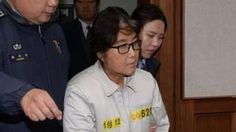 Image copyright                  Getty Images                                                                          Image caption                                      Ms Choi (centre) is accused of influence-peddling                                The woman at the centre of South Korea's political crisis, Choi Soon-sil, has appeared in court, where she d