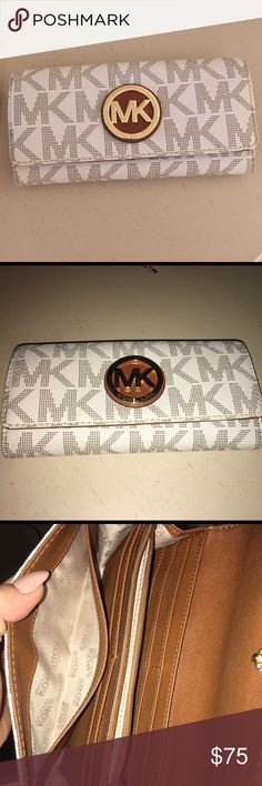 Michael Kors Wallet White monogram MK wallet. Has a mark on back as shown and scratches on the emblem. Great condition inside Michael Kors Bags Wallets
