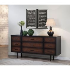 With a lovely finish of deep black that fades into a gorgeous cherry color, the exquisite and practical Preston dresser contains nine drawers. This durable piece is composed of rubberwood and MDF.