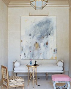 Be brave, be bold and choose a golden frame. Together with the small table and gorgeous lamp it gives this room a luxurious feeling. The gold brushstrokes in the painting pull it all together.