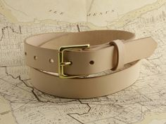 The Cyril Belt with Brass Roller Buckle. Cut, punched and burnished edges all done one belt at a time with sore hands and old tools. Free Personalization if you so please!   #Cyril #madetowander #madebyhand #handmade #cyrilleatherandsuch #leather #wander #sorehandsoldtools
