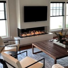 🔥🔥 Installed by August West Fireplace in gorgeous oceanfront home. Thanks to an incredible contractor, their talented carpenters and finish trades people this project was a complete success! Only with heat management technologies can you achieve this Small Living Room Decor, Room Design, Home Fireplace, Living Room With Fireplace, Fireplace Design, House Interior, Modern Fireplace, Living Room Design Modern, Living Room Tv