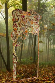 Love this mosaic mirror