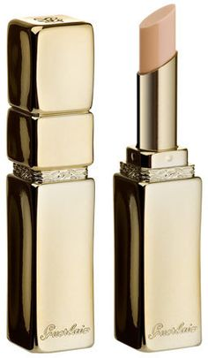 Guerlain KissKiss Liplift - Smoothes and evens out the texture of lips. Feels good and redefines lip line. Gives lipstick lasting color and hold. Presented in a gilded metal case designed by Herv Van Der Straeten.
