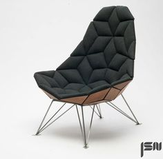danish furniture designer jonas søndergaard nielsen has produced the flexible 'tile chair' through an assemblage of diamond-shaped pieces. presented in the greenhouse of the stockholm furniture fair 2014, the product has upholstery applied to the front side from kvadrat, with back walnut veneer used for its underside.