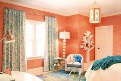 Coral grasscloth + turquoise + tree bookshelf