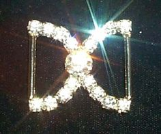 Rhinestone Jewelry Corporation  Nice buckles for vase wraps and more