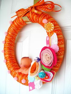 Orange and Kewpie Yarn Wreath by KnockKnocking, via Flickr