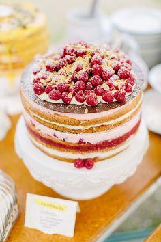 raspberry topped wedding cake, photo by Carmen & Ingo http://ruffledblog.com/german-barn-wedding #weddingcake #cakes