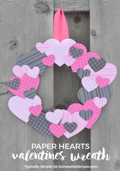 Dig through your scrapbook supplies stash or head to the craft store to pick out some fun Valentine's Day paper for this easy-to-make scrapbook paper hearts wreath. | http://SomewhatSimple.com