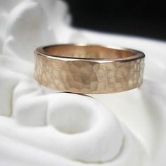 Pretty cool men's hammered wedding band.