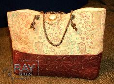 Purse Tote Measures: 8 High x 10 Wide x 4 Deep. Inside lined. No pockets inside or out. Velcro flap-over closure.