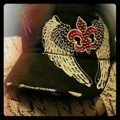NEW, Angel wings black women's hat New, light pink wings with a fleur-de-lis in red, sparkle jeweled hat.  Adjusts in back. Diesel Accessories Hats