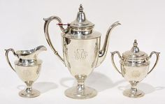 """(lot of 3) American M. Fred Hirsch sterling silver coffee pot, covered sugar, and cream pitcher, each Classical polished form mounted with loop handles, raised on a circular base, and fronted by a script monogram, tallest, 10.75""""h, 33.47 troy oz. Provenance: Property from the collection of Trotter's Antiques, Pacific Grove, CA"""
