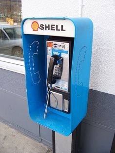 A Shell pay phone on the side of a building in Bellefontaine, Ohio. Antique Phone, Telephone Booth, Vintage Phones, Old Phone, Landline Phone, Crafts To Make, Inventions, Childhood Memories, How To Memorize Things