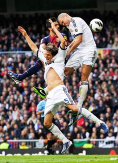 David Villa of FC Barcelona duels for a high ball with Fabio Coentrao and Pepe (R) of Real Madrid CF during the La Liga match between Real Madrid CF and FC Barcelona at Bernabeu on March 2, 2013 in Madrid, Spain. (David Ramos / Getty Images)