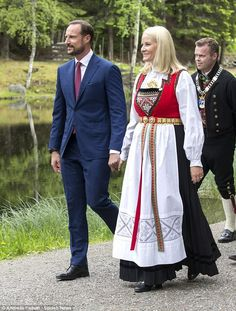 Crown Prince Haakon and Crown Princess Mette-Marit held hands as they made their way around the party.