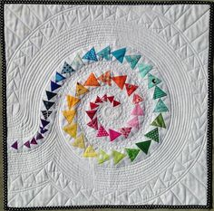 Spiral Geese mini quilt by Janice at Better Off Thread.  Includes a 'how to design' tutorial