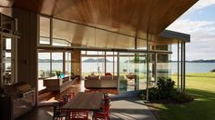 Fully glazed walls appear to support a heavy timber ceiling in the Fold House by Bossley Architects, winner of a 2016 NZ ...