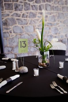 cute table number holder...would put the table names and photos in these. love the stone base to match our guest book idea