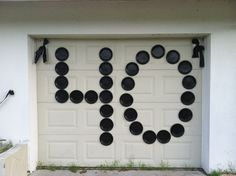 """Quick, easy and inexpensive way to display a large message! Use paper plates (dollar store) and tape. Perfect for """"punking"""" someone on their birthday! I punked my neighbor on his 40th birthday....$2.00 worth of black paper plates from the dollar store and about a $1 worth of packing tape to adhere the plates to his garage door."""