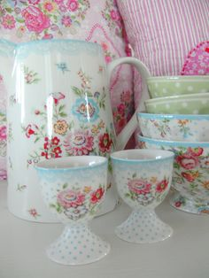 DINING / KITCHEN Love the mixing of vintage china patterns.