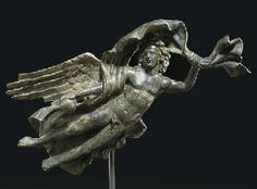 A ROMAN BRONZE ATTACHMENT IN THE FORM OF AION     									CIRCA MID 2ND CENTURY A.D.