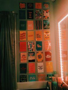 A VSCO photo wall I created by my vanity.