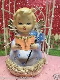 angel figurines holding books - Google Search