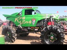 A close up look of Dennis Andersons mega mud truck King Sling. This thing is a work of art. It has the same exact engine has his Monster truck Grave Digger and it weighs several thousand pounds less. As you can see Dennis always puts on a good show for everyone watching.