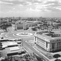 Philippines - A roundabout with a fountain sits between old buildings in Manila. Some areas of the city were destroyed during World War II, when the country was invaded by Japan and then liberated by the United States. Uk Visa, Philippines Culture, Exotic Beaches, Crystal Clear Water, Time Photo, Back To The Future, Old Buildings, Manila, Southeast Asia