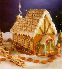 gingerbread house w/ frosted mini-wheast roof..smart!   (I am researching ideas for a contest at work!)
