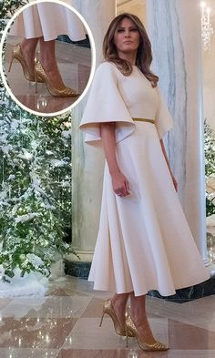 Unveiling the White House holiday decorations on November 27 as she prepared to celebrate her first-ever Christmas as first lady, Melania donned an angelic white bell-sleeved dress by Christian Dior. The President's wife added a touch of festive elegance with a vintage gold belt and gold Manolo Blahnik heels.