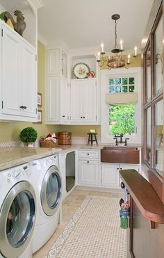 Laundry room with copper accents--chandelier, farm sink, etc.--dutch door, and built-in dog bed.