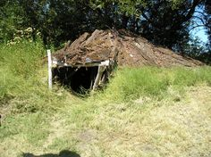 This is a replica of a sweat house used by the Ohlones for cermonies and cleansings.  It is built near the water for easy access when a cold dunk is needed.  (Freemont, Ca)