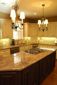Dark cabinets allow the stone counter top to be the feature.