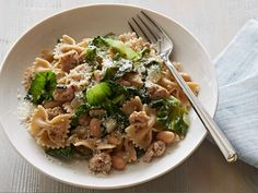 Pasta with Escarole, White Beans and Chicken Sausage : Ellie manages to pack a whopping 30 grams of protein into just one serving of this pasta dish with help from whole-wheat bowtie pasta, chicken sausage and cannellini beans. The escarole is key to adding a leafy crunch and, most important, fiber.