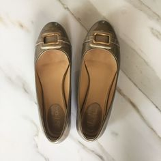 dacc6ad181 These Cole Haan Gold Flats are a top 10 member favorite on Tradesy.