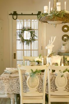 Love the greenery accent on the chairs and the door wreath