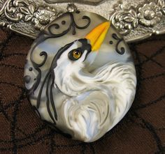 Here is a new heron bead for you! This dramatic heron is majestically posed against a stormy grey sky. Delicate tapestry scrollwork both front and
