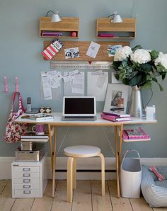 Extra desk shelving: hidden when you're working but pretties up the space when you're not