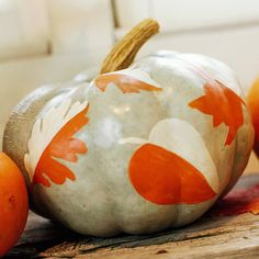Paint a pretty leaf pattern for pumpkins that span from Halloween to Thanksgiving. More painted pumpkin ideas: http://www.bhg.com/halloween/pumpkin-decorating/painted-pumpkin-ideas/